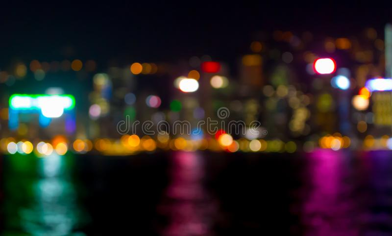 Reflection of night lights in the water of Victoria Harbour in Hong Kong stock photography