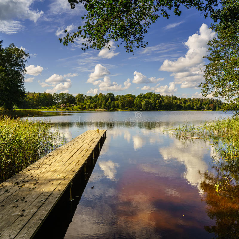 Free Reflection Of Clouds In The Lake With Boardwalk Stock Image - 48526321