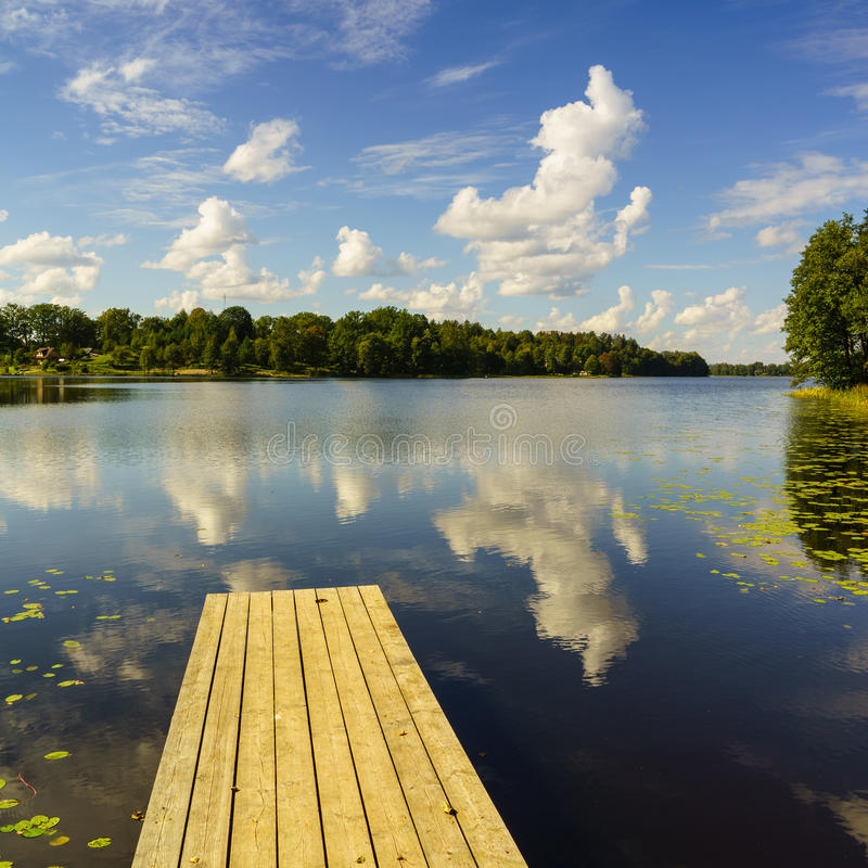 Free Reflection Of Clouds In The Lake With Boardwalk Stock Photo - 48526520