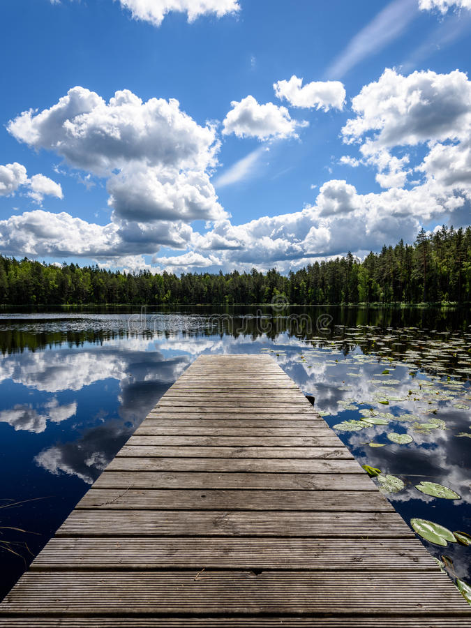 Free Reflection Of Clouds In The Lake With Boardwalk Royalty Free Stock Images - 94973489