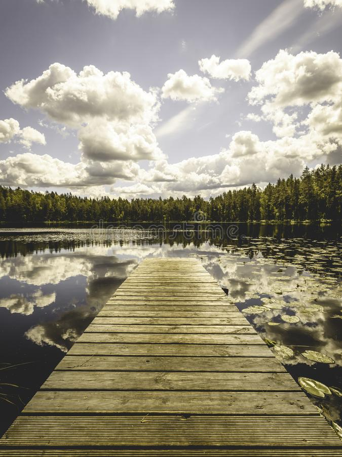 Free Reflection Of Clouds In The Lake With Boardwalk - Vintage Old Effect Stock Photos - 109146593