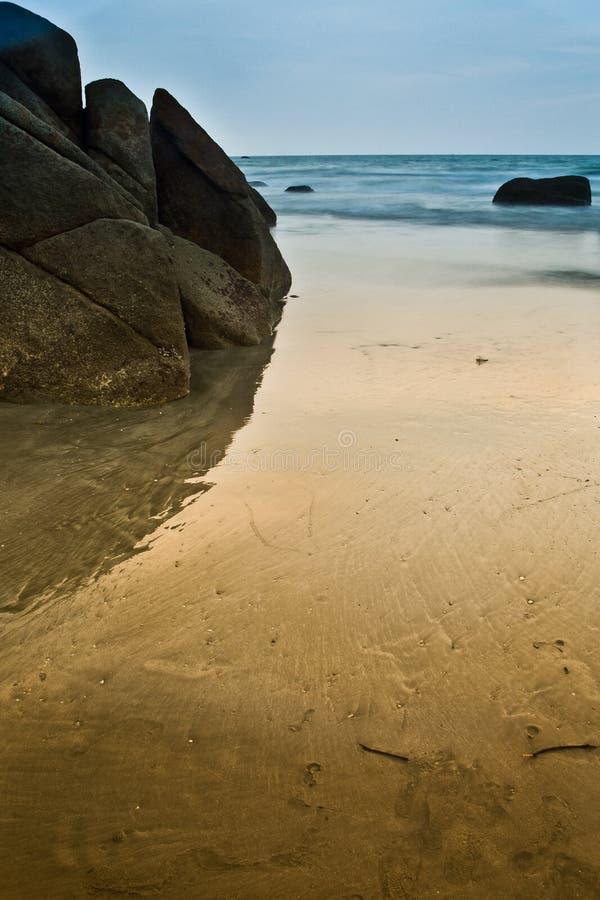 Free Reflection Of Rock On Beach Stock Photos - 11345473