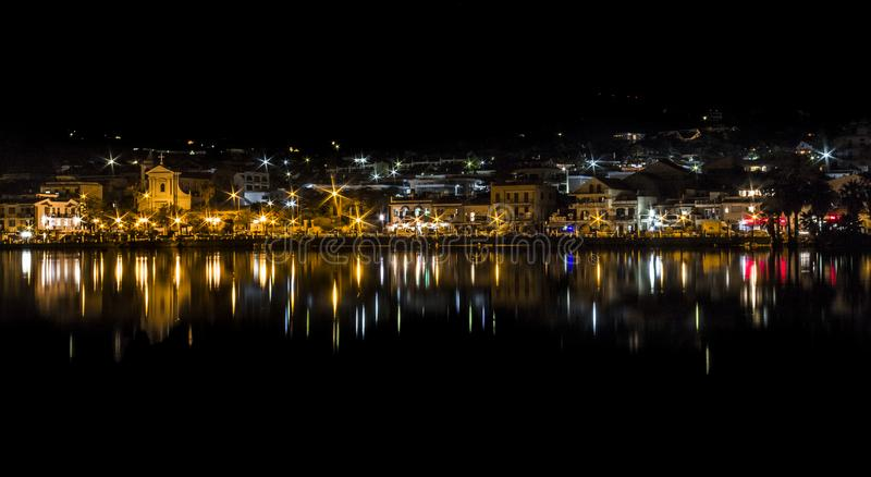 Reflection over water at night: a lake in Ganzirri Messina, Sicily. This photo was taken at night at the large lake of Ganzirri, in Messina Sicily. The image royalty free stock photography