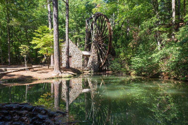 Reflection in the pond in front of the Old Grist Mill at Berry College in Georgia stock images
