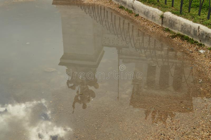 A reflection in a puddle after the rain Statue in the Vittoriano monument of Vittorio Emanuele II in Rome, Italy on stock images
