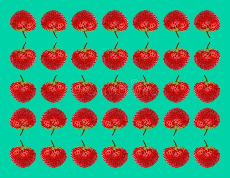 Reflection. Ripe strawberries. Sweet berries strawberries on a turquoise background. stock photo