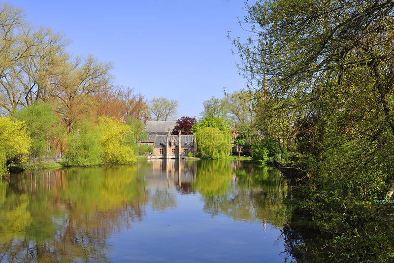 Reflection in river, Bruges stock photography