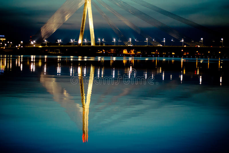 Reflection in the river cable-stayed bridge in Riga City. Night scape of river Daugava in Riga City royalty free stock image