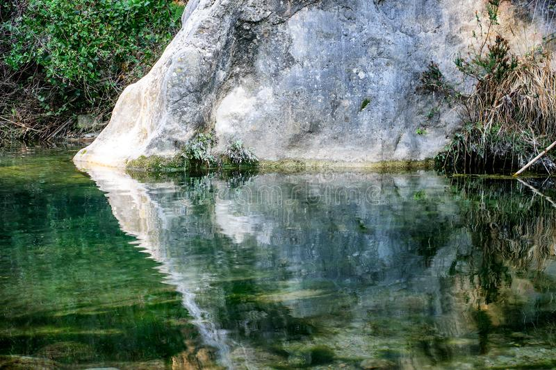 Reflection of the rock in the water. stock photo