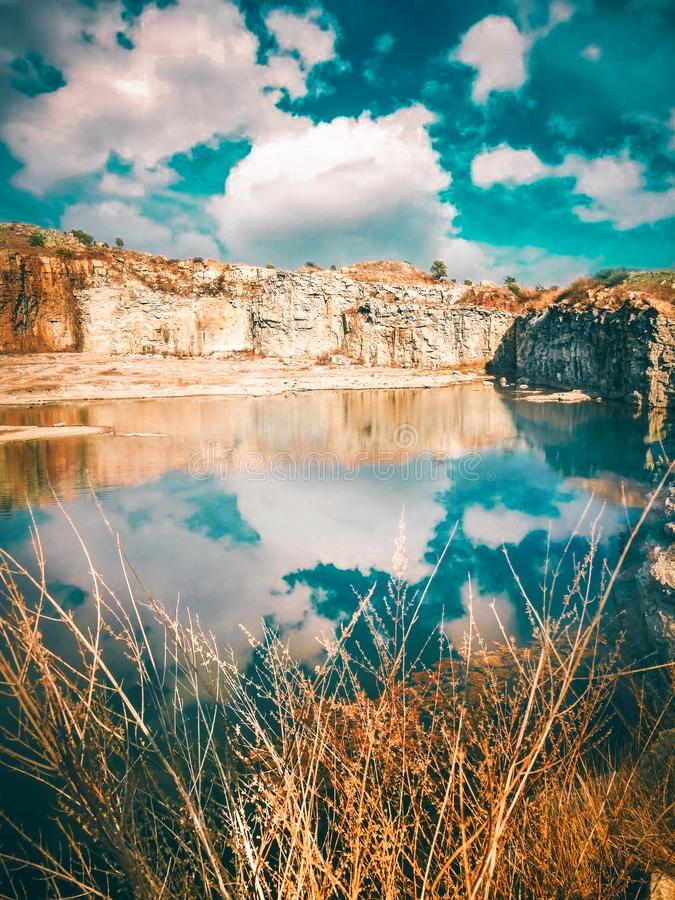 Reflection of sky in  a mining spot royalty free stock image