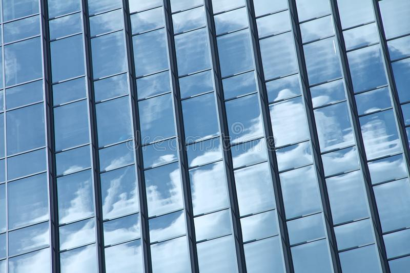 Reflection of the sky in a sky scraper stock photo