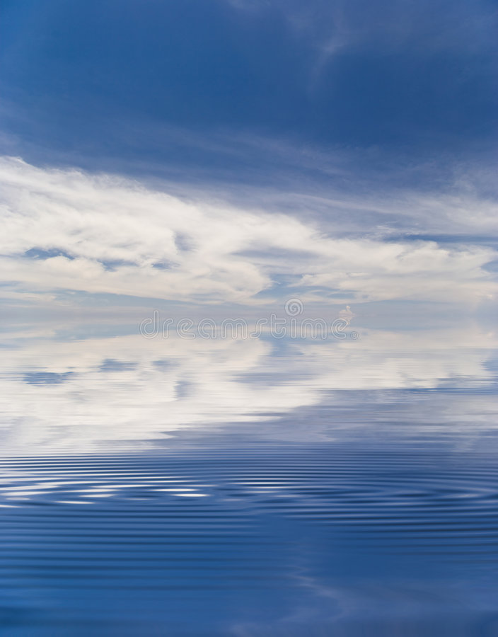 Reflection Of The Sky In Water Stock Photo