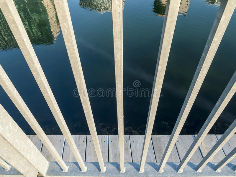 Reflection of skyline through railing royalty free stock images
