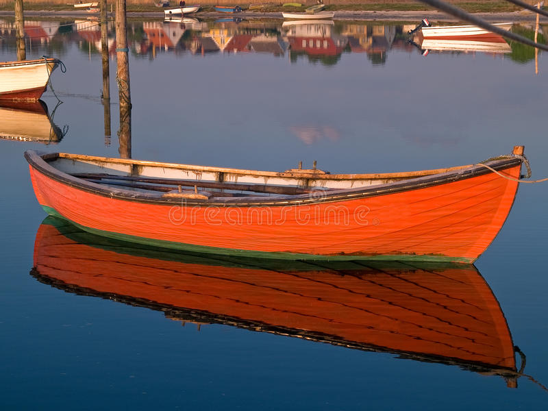Reflection of a small dinghy dory boat stock photography