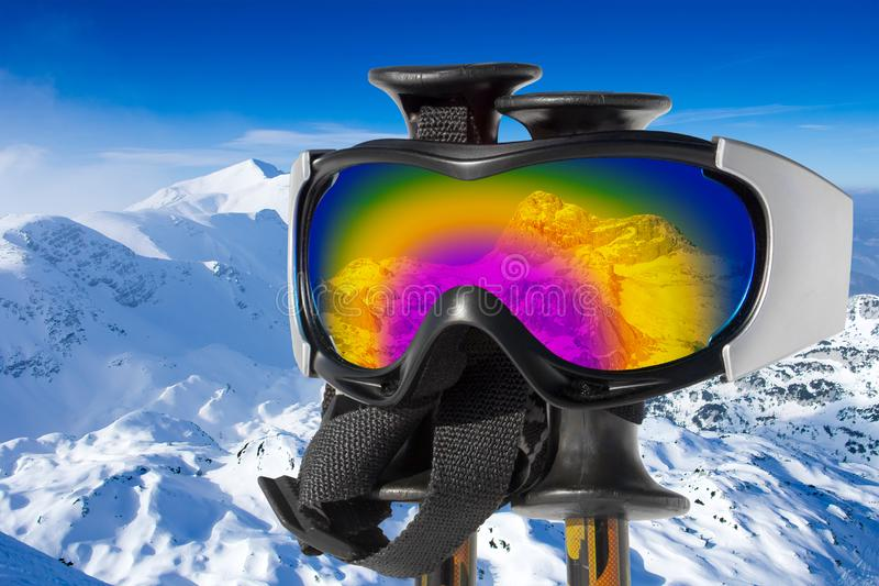 Reflection of the snowy mountain Triglav in ski goggles royalty free stock photography