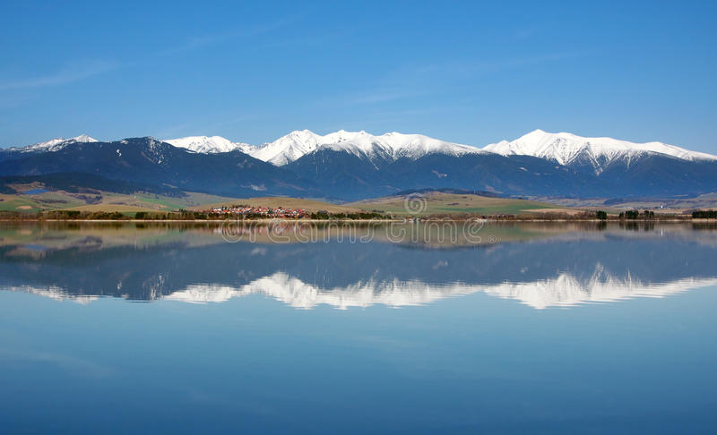 Reflection of snowy Rohace mountains royalty free stock photography