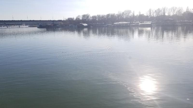 Reflection of the sun from the Danube. This is image of Reflection of the sun from the Danube from southeastern Europe stock images