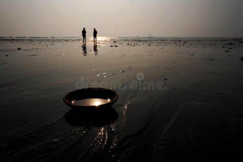 Indian deepak lit by Sun. stock image