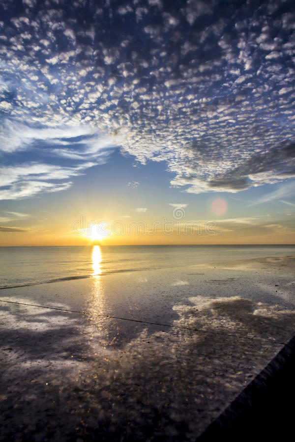Reflection sunrise On a marble bench stock photography