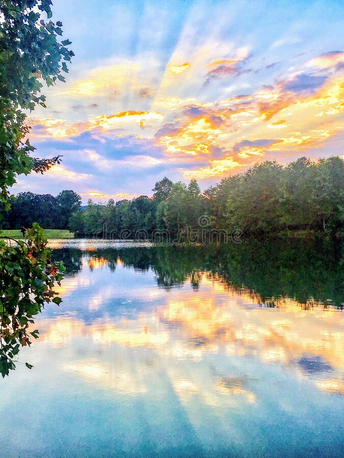 Reflection of a Sunrise Over a Lake stock image