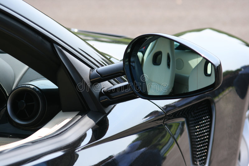 Reflection in supercar door mirror royalty free stock photos