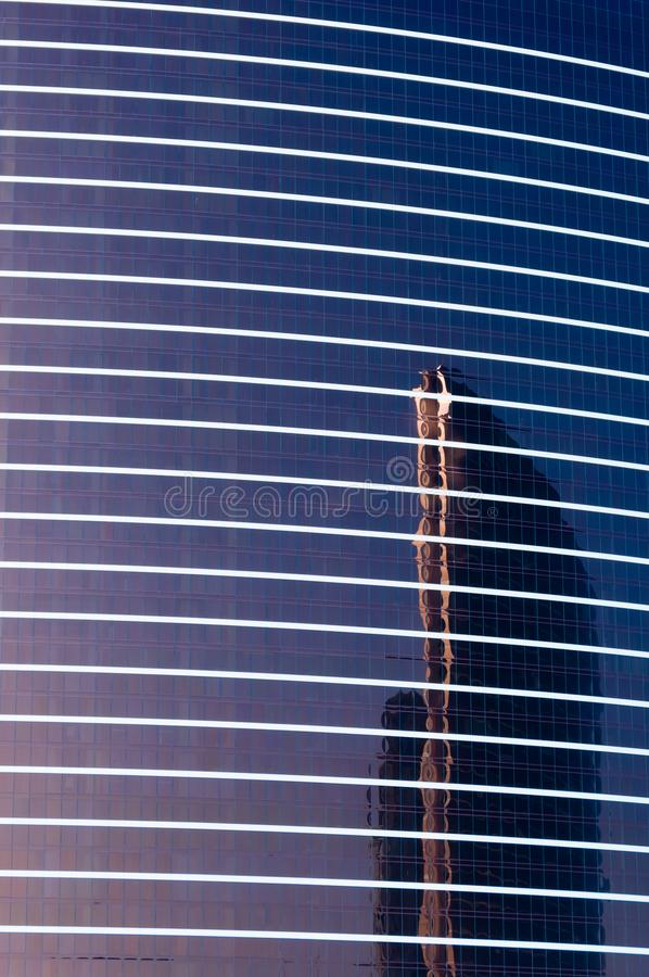 Reflection of a tall skyscraper in the windows of another tall building stock photo