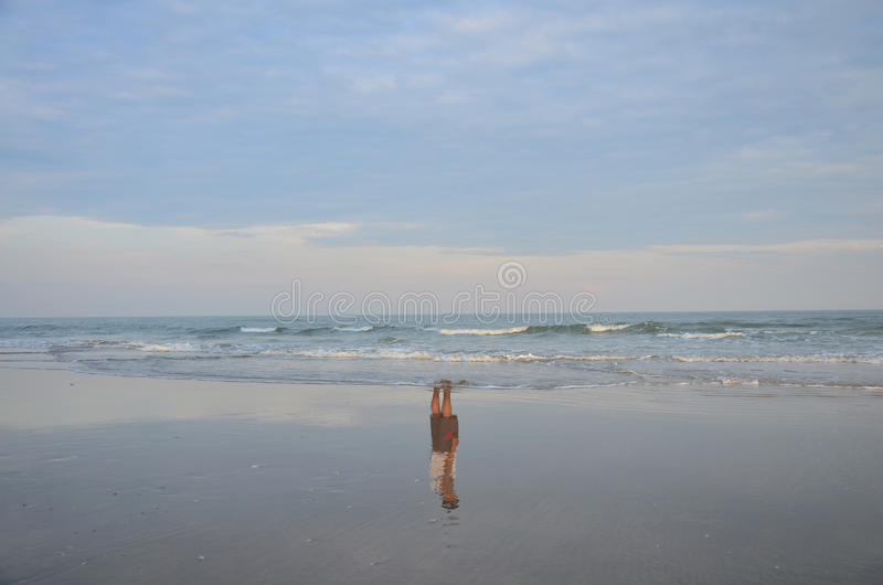 Reflection of thai man standing on beach of sea royalty free stock images