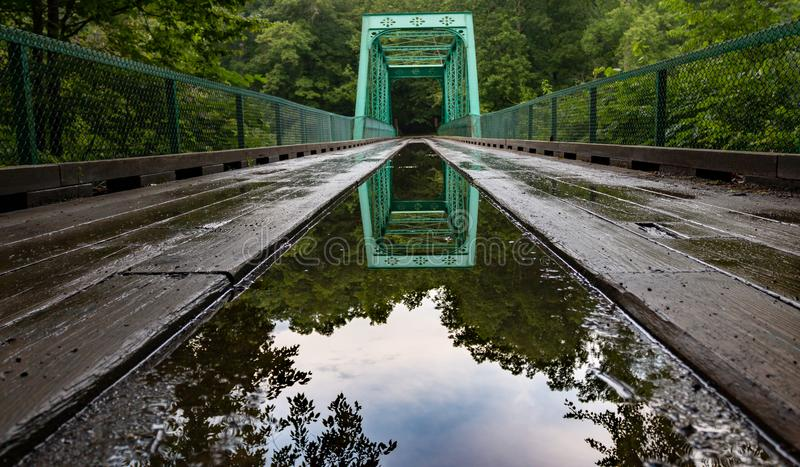 A reflection of time through the bridge of life stock photo