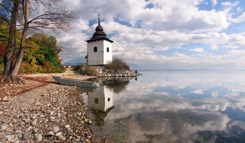 Reflection of tower at Liptovska Mara, Slovakia royalty free stock photo