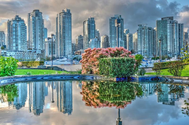 Reflection of Vancover skyline. Spring colours at False Creek. Vancouver. British Columbia. Canada royalty free stock image