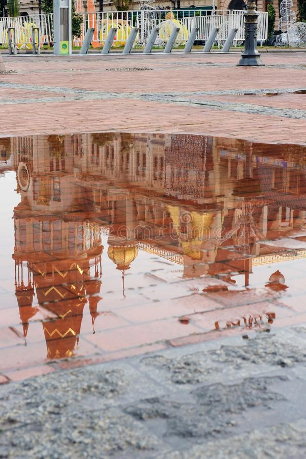 Reflection of the building on puddle royalty free stock photo