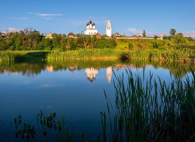 Reflection in the water of an ancient monastery in the city of Suzdal. The beauty of the Russian province. Reflection in the water of an ancient monastery in the royalty free stock photography