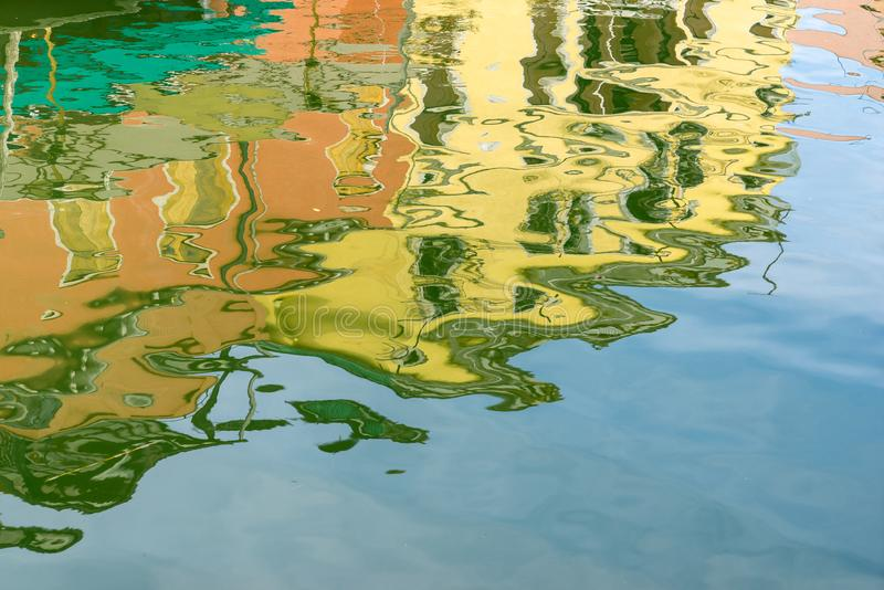 Reflection in the water of a canal in Venice royalty free stock photo