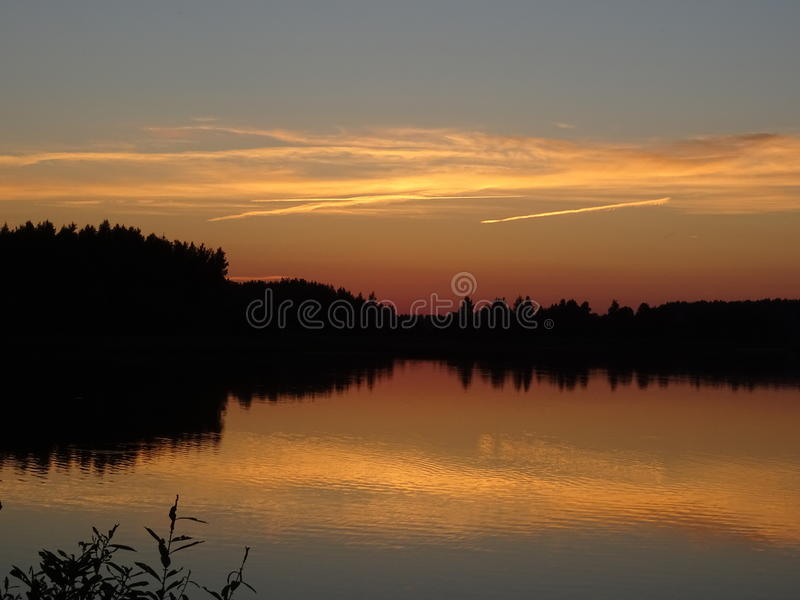 Reflection. Water nature forest heaven clouds stock photo