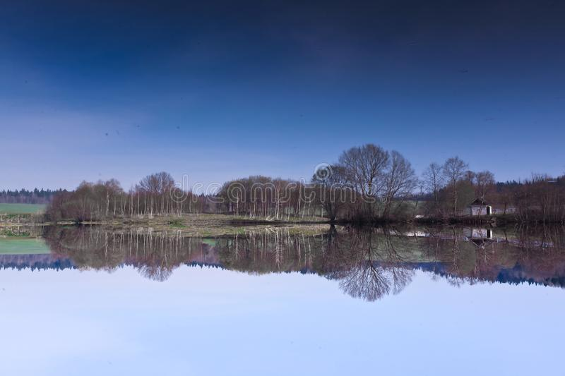 Reflection of water in the sky.The picture is turned upside dow. Reflection of water in the sky. The picture is turned upside down, there is a blue sky from stock images