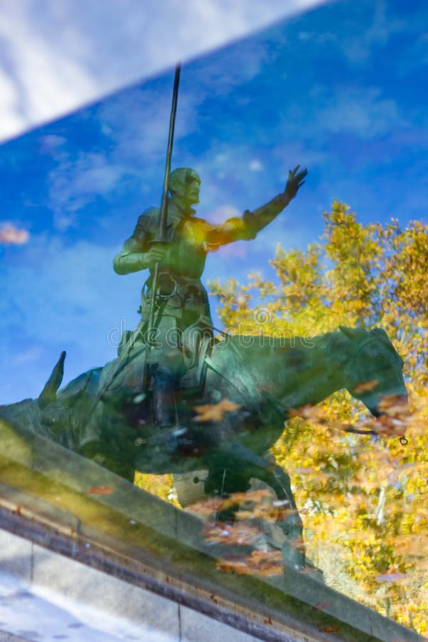 Reflection in the water of a statue of Don Quixote stock photos