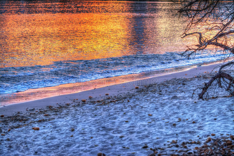 Reflection on the water at sunset. Colorful reflection on the water at sunset stock image