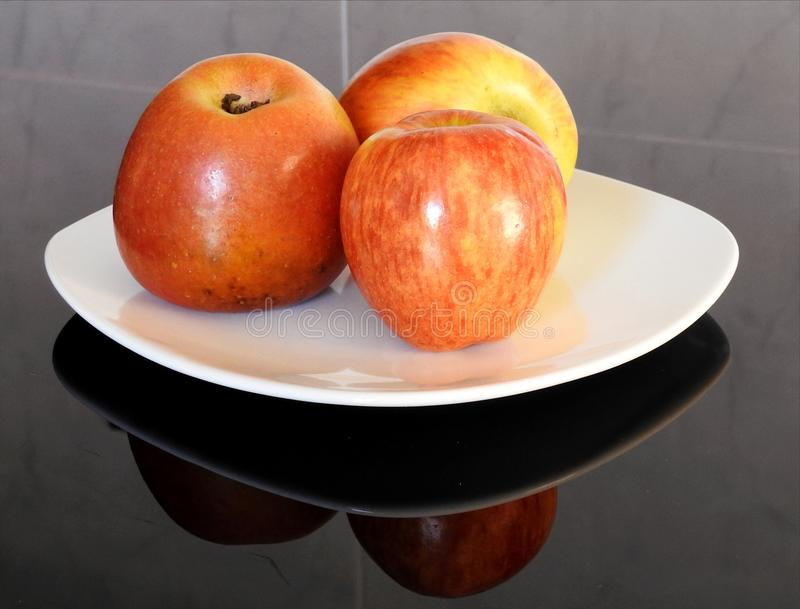 Reflections of the apples on the table royalty free stock photo