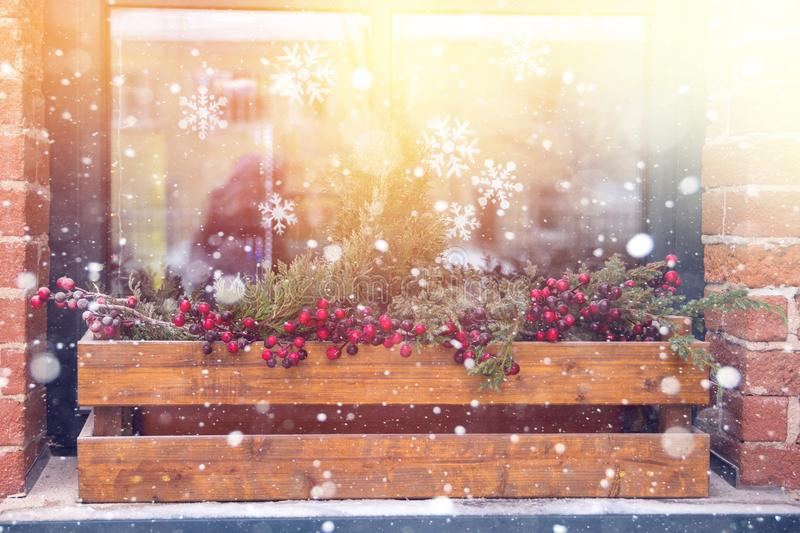the reflection in the window of the Christmas lights and people as a background, substrate, and bright royalty free stock photo