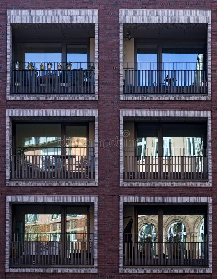 Reflection in window on residential building. Balconies royalty free stock images