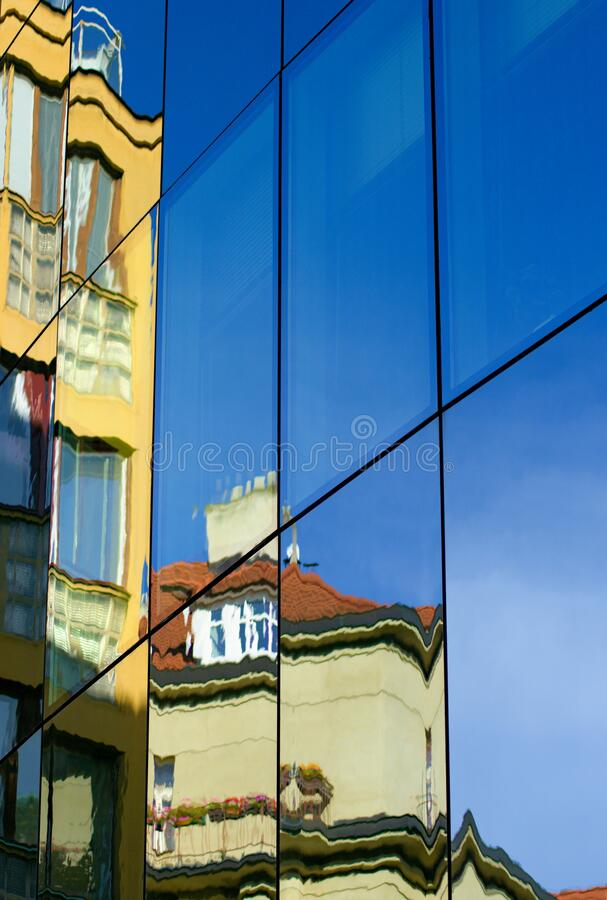 Reflection in the windows of a building stock images