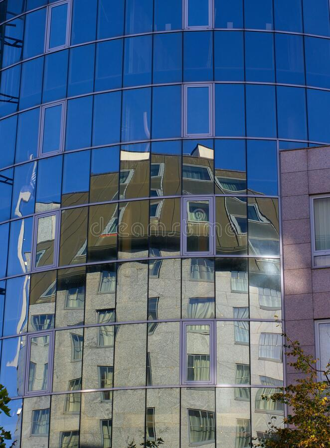 Reflection in the windows of a office building stock photo