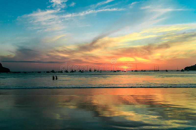 Reflections on beach water. During sunset royalty free stock images