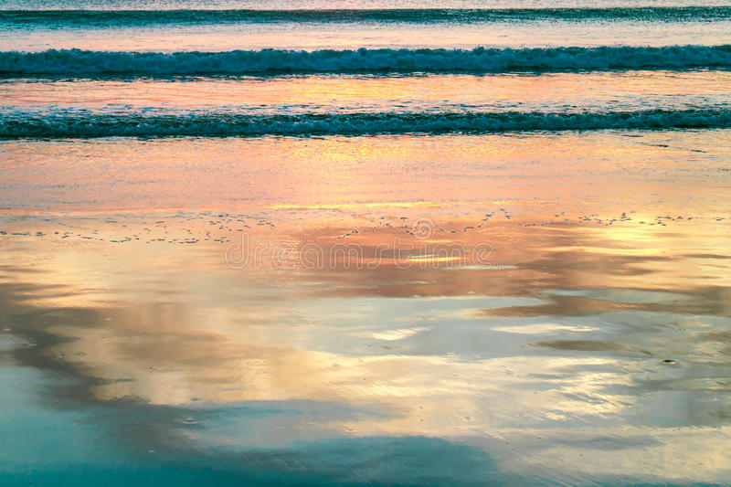 Reflections on beach water on sunset. Reflections on beach water during sunset stock photo