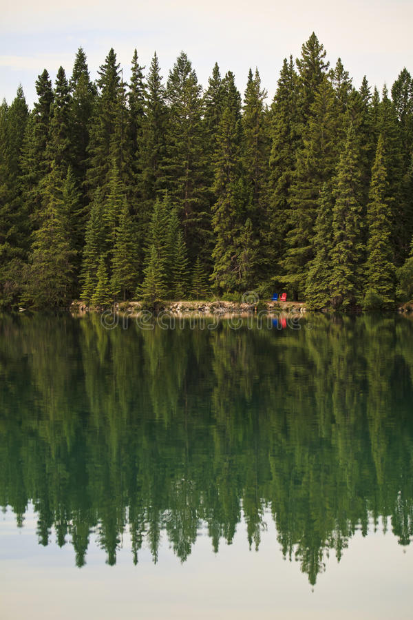 Reflections on Beaufort Lake in the Canadian Rockies stock image