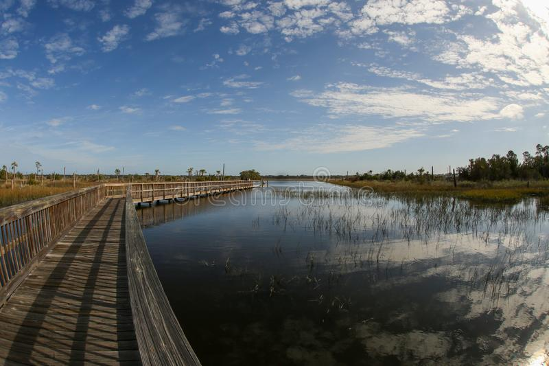 Reflections of a Beautiful Sky at Castaway Island Preserve. A beautiful sky is reflected in the water at Castaway Island Preserve in Jacksonville, Florida stock photos