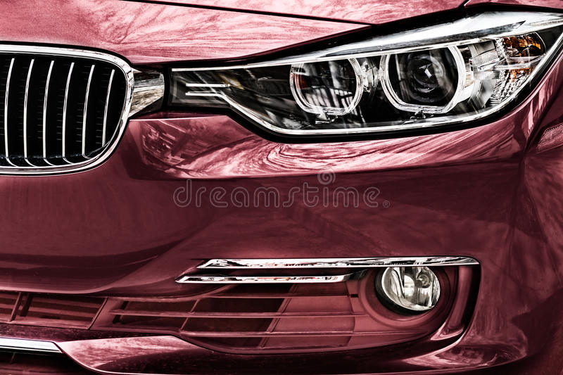 Reflections on car paint and headlights royalty free stock image
