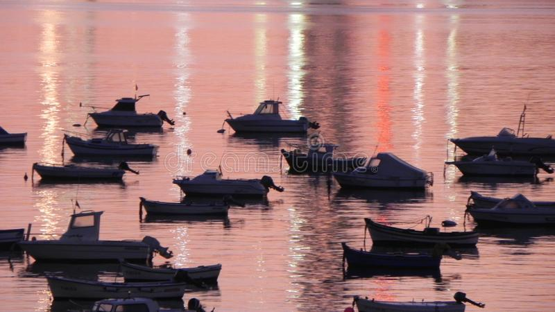 Reflections of the city lights. On a river with boats royalty free stock photography