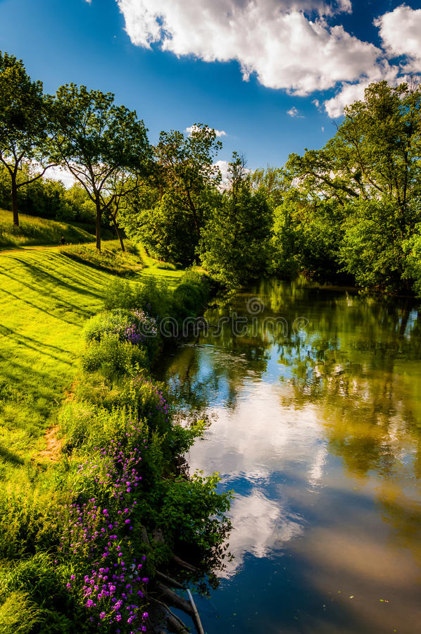 Reflections of clouds and trees in Antietam Creek, at Antietam N stock images
