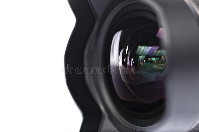 Reflections in the glass of a photographic camera lens stock photography